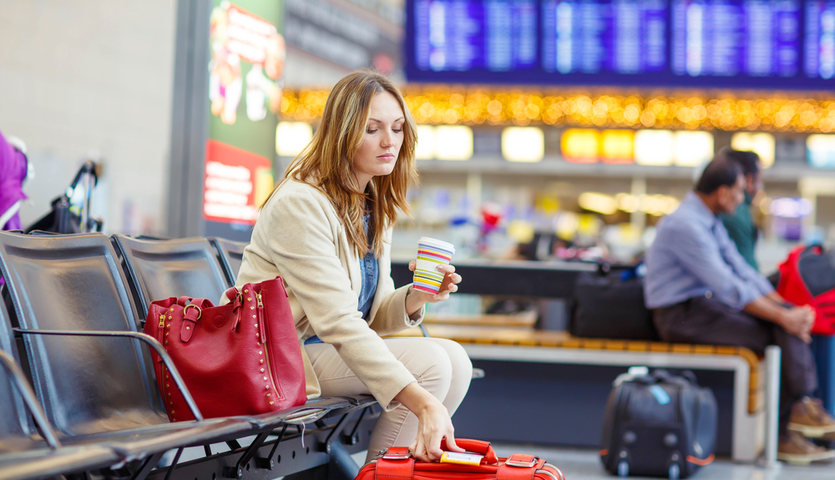 woman-sitting-in-airport-with-coffee