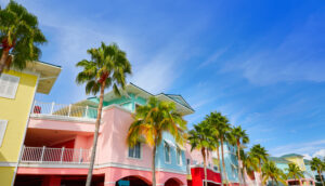 colorful beach houses in fort myers florida with palm trees