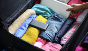 Rolling clothes for packing a suitcase