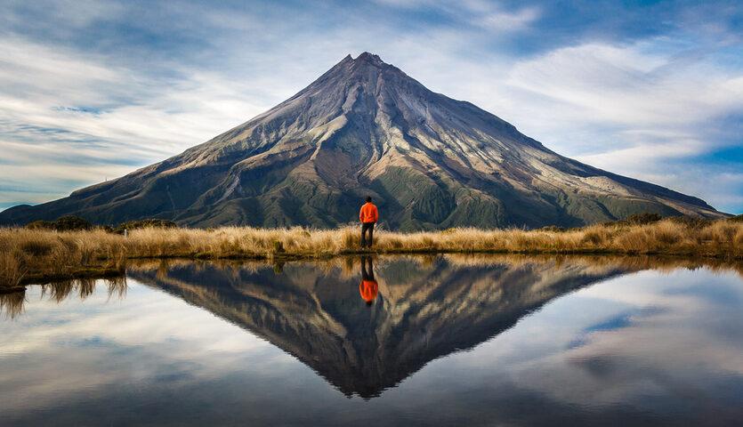 climber looking at taranaki volcano in the north island of New Zealand