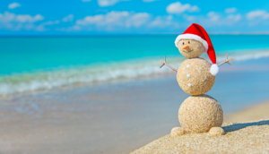Alt tag not provided for image https://blog.airfarewatchdog.com/uploads/sites/26/2019/12/snowman-beach-sand-xmas-santa-christmas-300x172.png