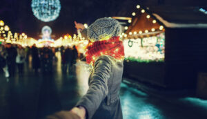 Alt tag not provided for image https://blog.airfarewatchdog.com/uploads/sites/26/2019/12/woman-holding-hands-christmas-market-300x172.jpg