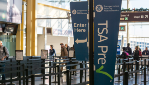 TSA PreCheck sign at the airport security line