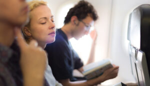 three-people-sitting-in-plane