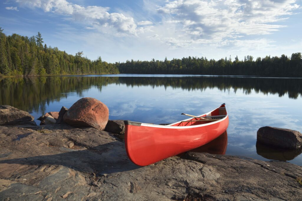 canoe on rocky shore of lake in the Boundary Waters of Minnesota